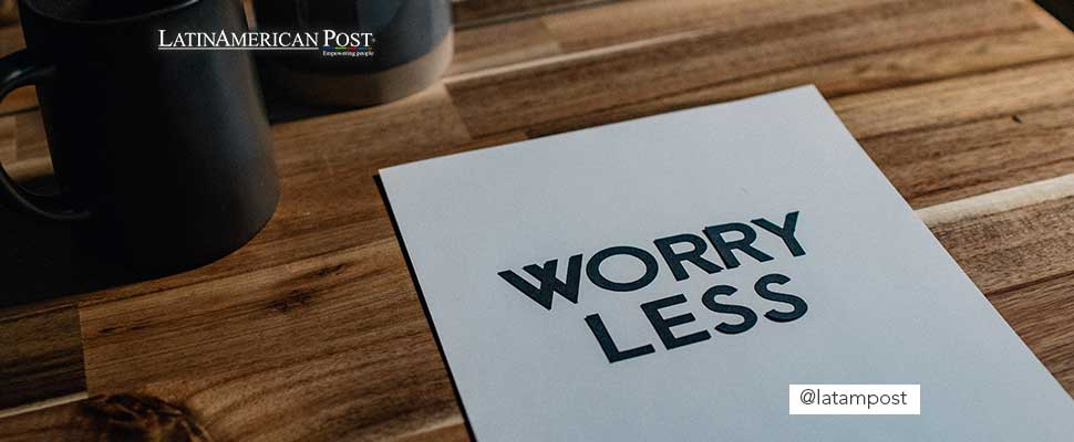 Sign 'Worry Less' on paper