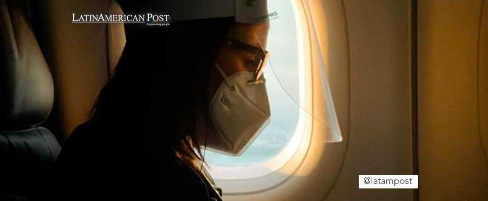 Woman wearing a face mask inside an airplane
