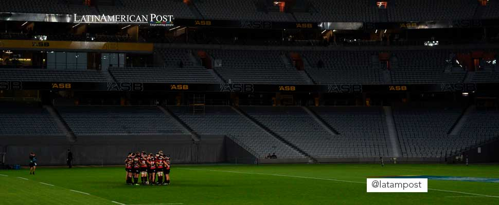 Group of soccer players in an empty stadium