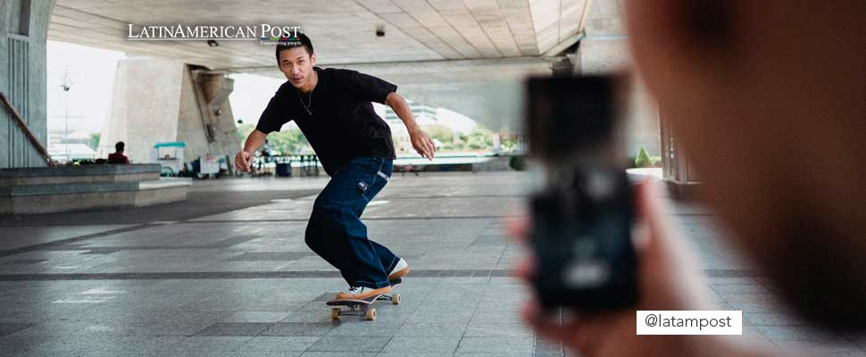 Person filming a skateboarder