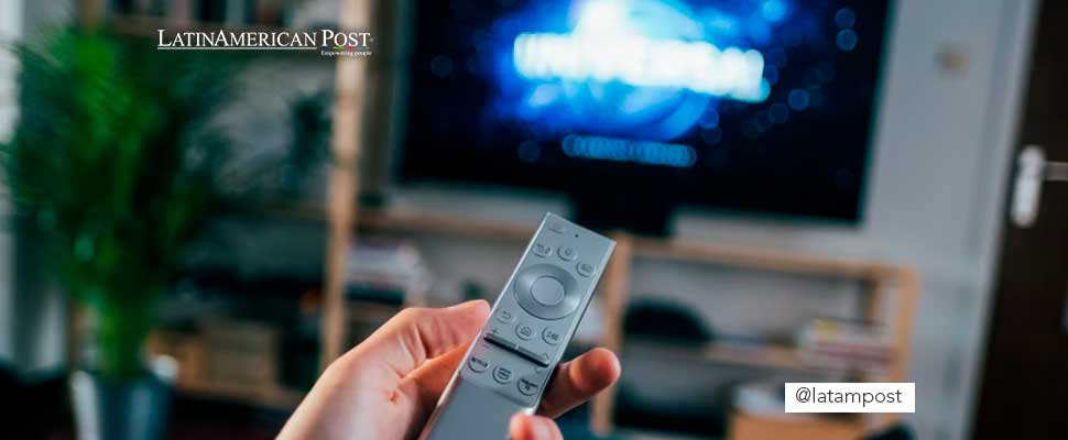 Person holding a TV control