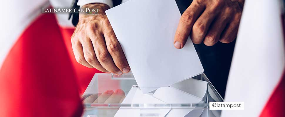Person putting a vote on a ballot