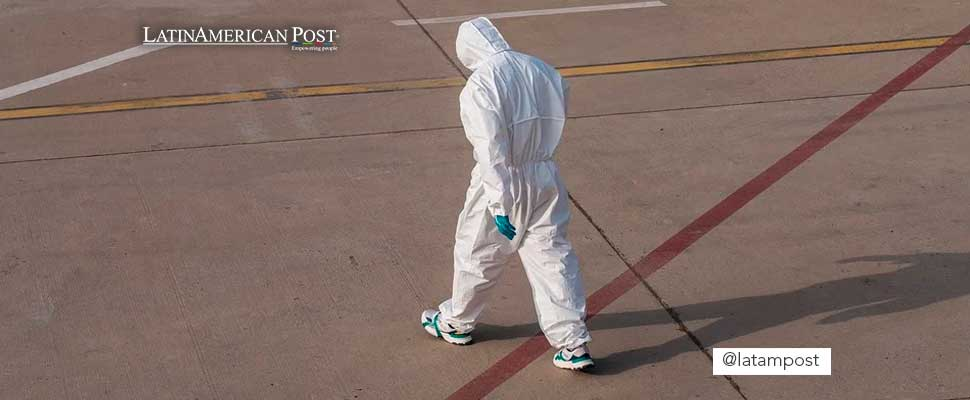 Person wearing a biosafety suit