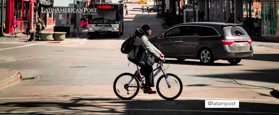 Man riding a bicycle on a street