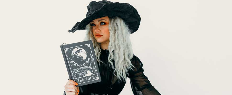 Woman wearing a witch costume