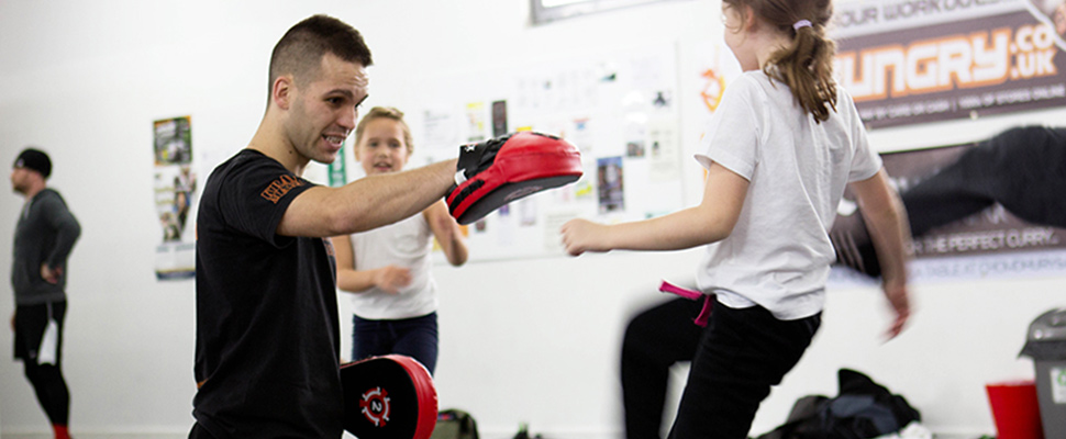 What are the benefits of teaching kids self-defense?