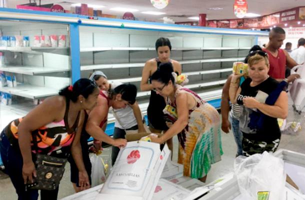 People buy chicken in a supermarket in Havana, Cuba. Reuters