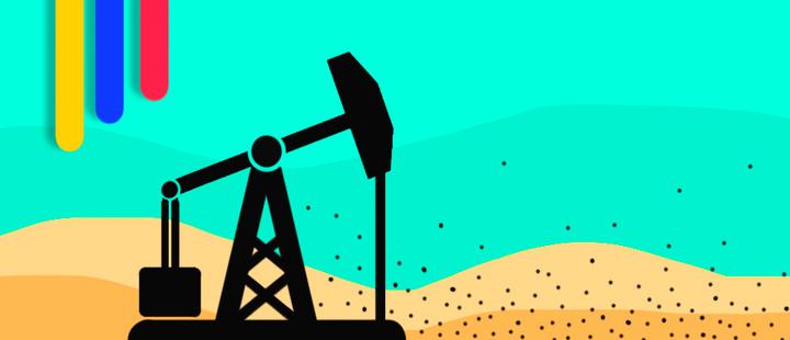 Máquina de extracción de petróleo en un desierto y la bandera de Colombia
