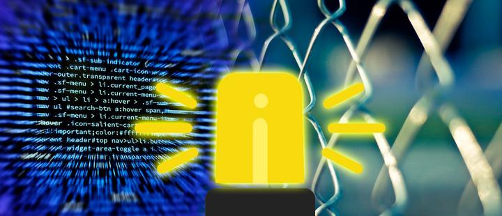 Alarma y detrás una pantalla con códigos y malla de alambre