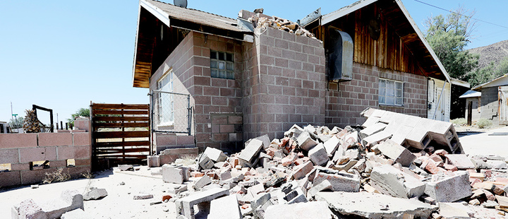 A house is left damaged by an earthquake, triggered by a previous day quake, near the epicenter in Trona, California