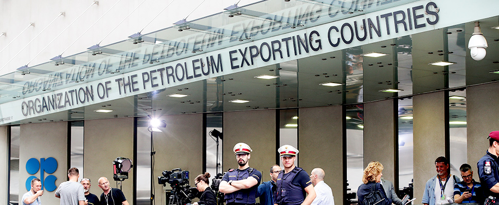 Police watch the headquarters of the Organization of Petroleum Exporting Countries.