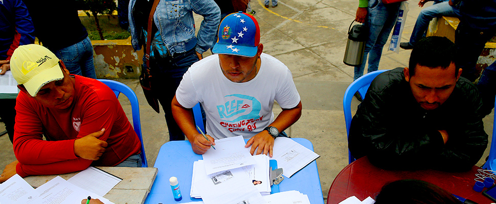 Venezuelan citizens submit documents in La Victoria, Lima, Peru.