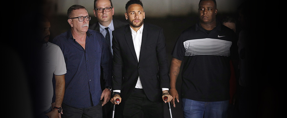 Brazilian soccer player Neymar leaves a police station in Sao Paulo