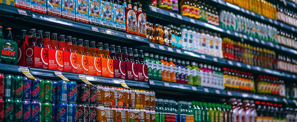 Supermarket shelves with sugary drinks
