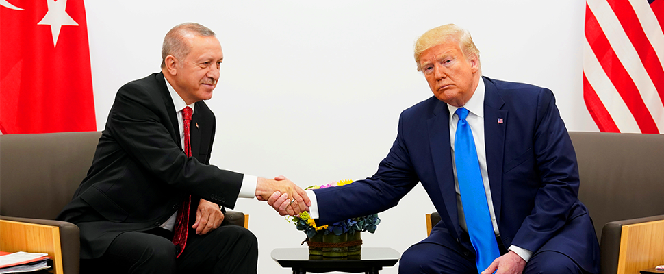 Donald Trump and Tayyip Erdogan shake hands