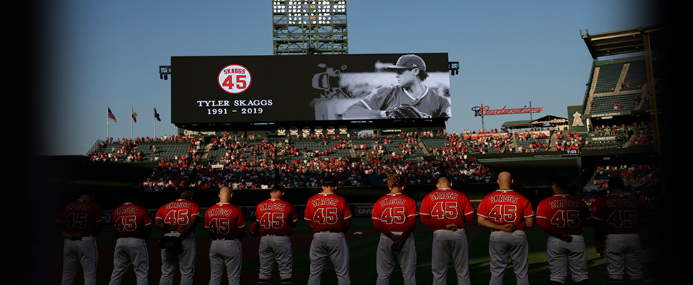 Members of the Los Angeles Angels observe a moment of silence for teammate Tyler Skaggs