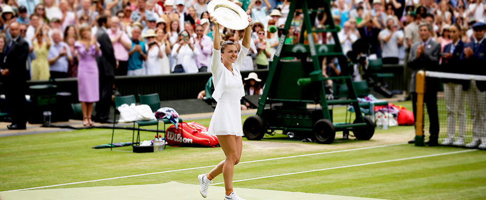 Simona Halep holds her trophy of the Wimbledon Tennis Championships in London