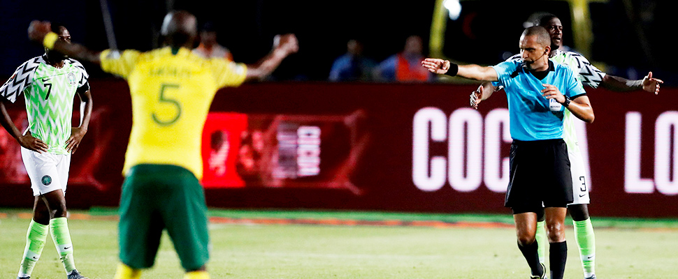Referee Jiyed Redouane awards a goal to South Africa after a VAR review