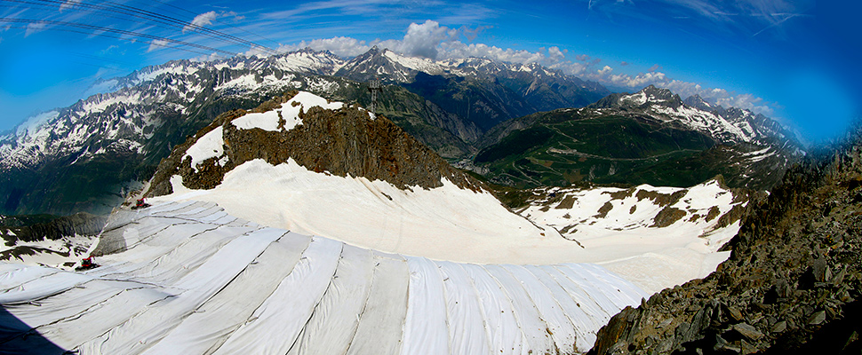 Parts of the Gurschengletscher glacier are covered with tarps in Andermatt, Switzerland