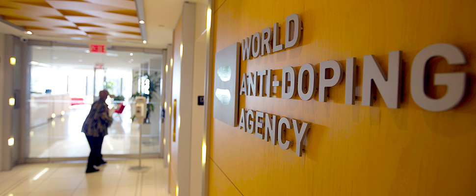 A woman walks into the head office of the World Anti-Doping Agency (WADA) in Montreal, Quebec, Canada