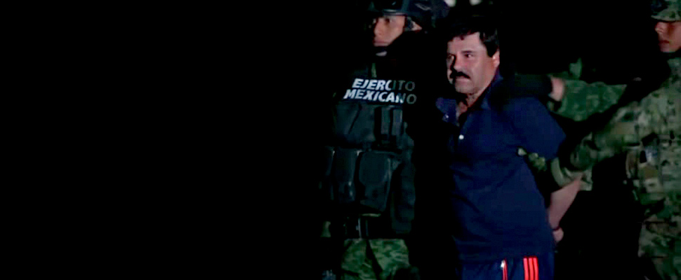 Acussed drug lord Joaquin 'el chapo' Guzman being walked from military vehicle