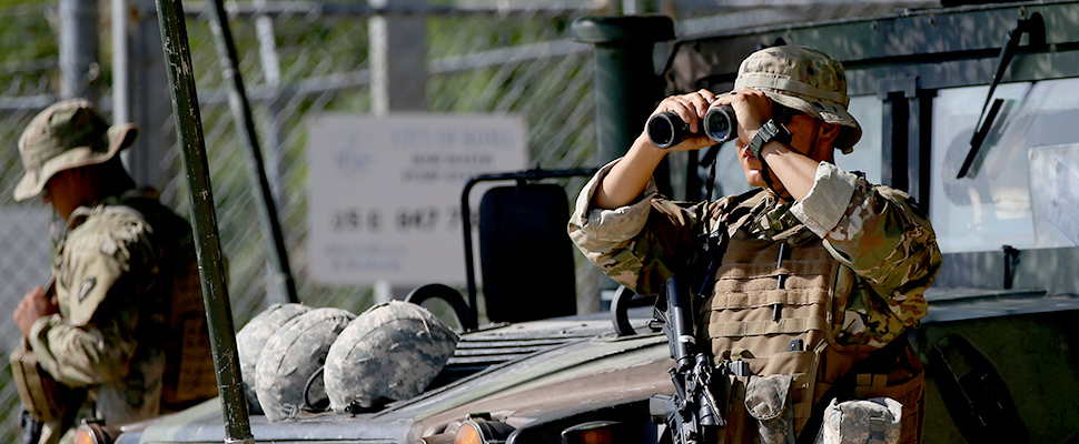 A member of the Texas National Guard watches the Mexico-U.S. border from an outpost along the Rio Grande in Rome, Texas, U.S., April 11, 2018 /