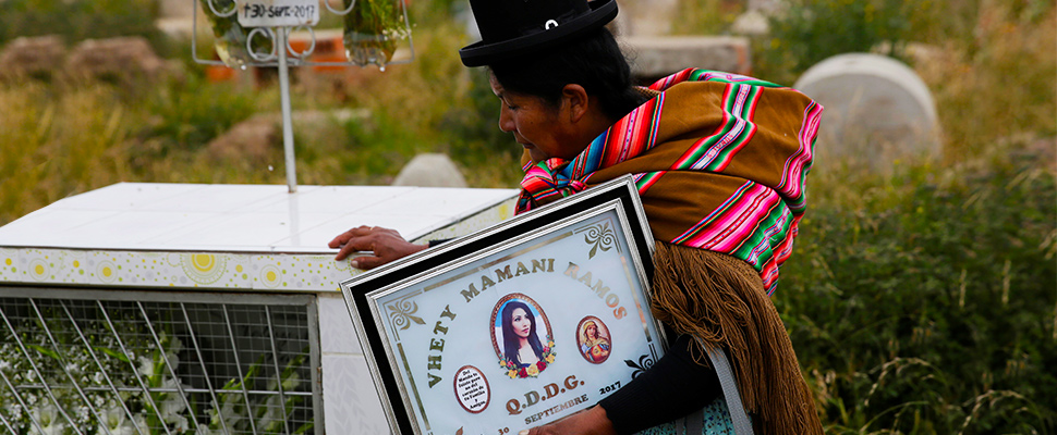 Bartolina Ramos visits the tomb of her daughter Vethy Mamani Ramos at a cemetery in Colquencha near La Paz, Bolivia