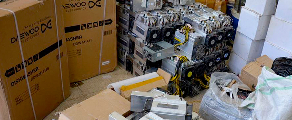 "This photo shows boxes of machinery used in Bitcoin ""mining"" operations that were confiscated by police in Nazarabad, Iran"