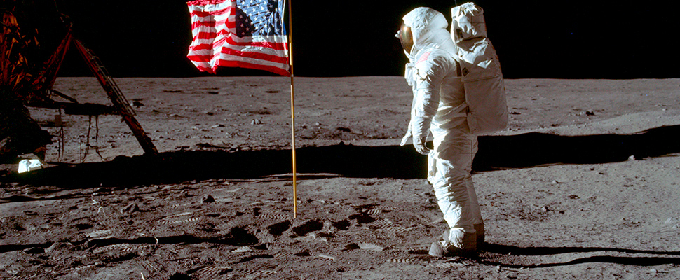 Astronaut Buzz Aldrin Jr. poses for a photograph beside the U.S. flag on the moon during the Apollo 11 mission.