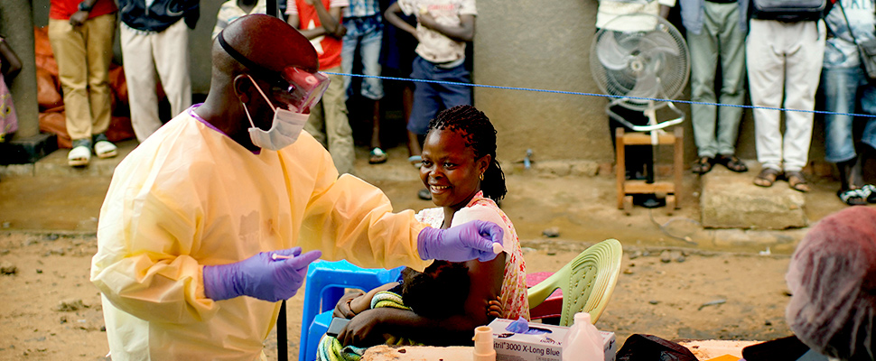 A nurse vaccinates a child against Ebola in Beni, Congo DRC.