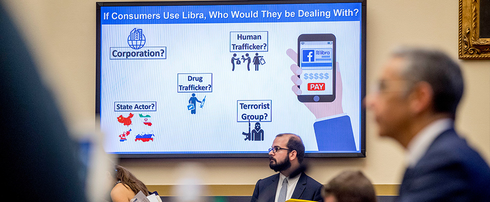 "A screen the reads ""If Consumers Use Libra, Who Would They Be Dealing With?"" is displayed with questions on potential user actors as David Marcus, CEO of Facebook's Calibra digital wallet service"