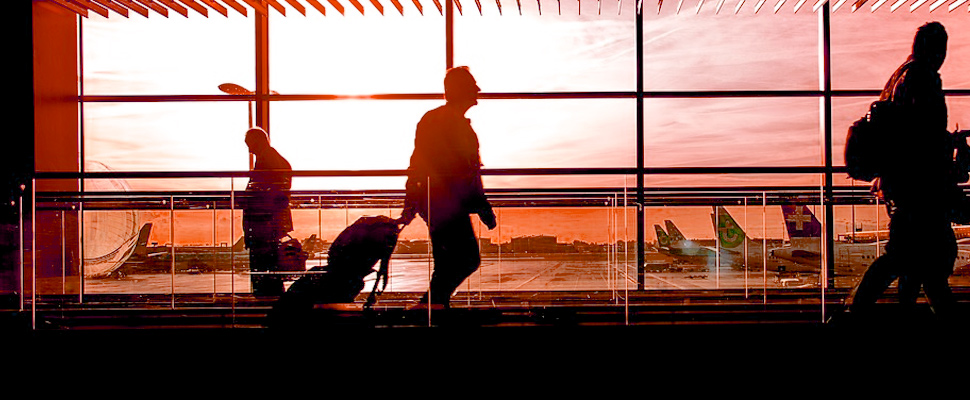 Man walking through the boarding area of an airport