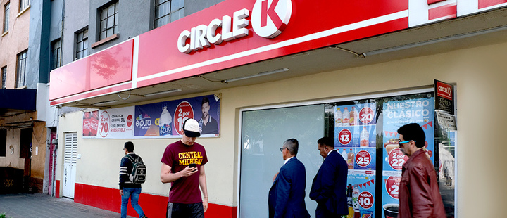 People walk past a Circle K convenience store in Mexico City, Thursday, July 18, 2019.