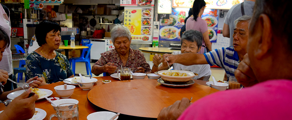 A group of elderly people at a lunch gathering organized by a charity in Singapore