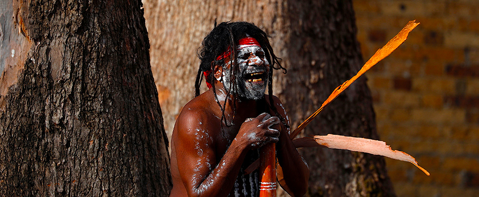 Aboriginal performer known as 'Turtle' reacts as he holds his didgeridoo during a ceremony to mark the start of National Reconciliation Week for Aboriginal and Torres Strait Islanders in Sydney, Australia