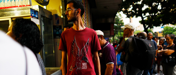 Several people walk through the streets of Caracas after a massive blackout left the city and other parts of the country without electricity, in Caracas, Venezuela