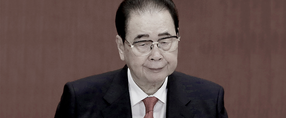Former Chinese Premier Li Peng attends the opening session of the 18th Communist Party Congress at the Great Hall of the People in Beijing.