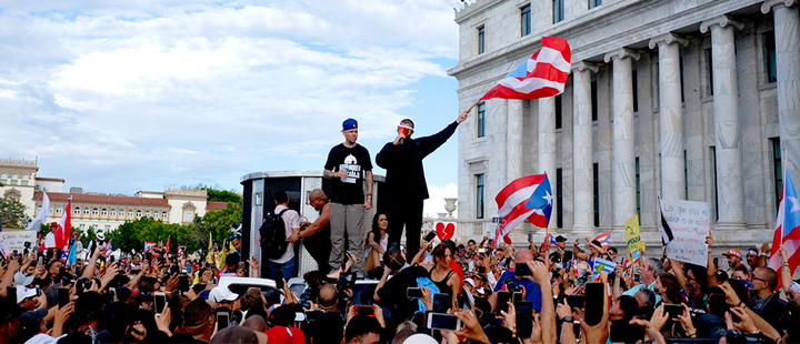 Puerto Rican rapper Rene Juan Perez and Benito Antonio Martinez Ocasio, warm up the crowd in front of the Puerto Rican Capitol, before a protest march against governor Ricardo Rosello, in San Juan, Puerto Rico,