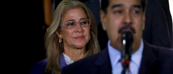 First lady Cilia Flores stands behind her husband Venezuela's President Nicolas Maduro during a press conference, at Miraflores Presidential Palace, in Caracas, Venezuela.