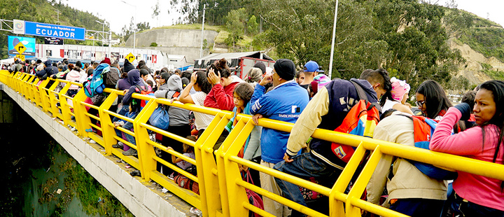 Venezuelans stand in line to cross into Ecuador from Colombia, most of them to reach Peru ahead of a June 15 deadline of new migration laws, at the Rumichaca International Bridge in Tulcan, Ecuador June 14, 2019.