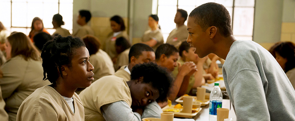 "FILE - In this file image released by Netflix, Uzo Aduba, left, and Samira Wiley appear in a scene from ""Orange is the New Black."""