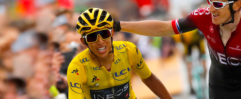 Britain's Geraint Thomas, right, congratulates Colombia's Egan Bernal wearing the overall leader's yellow jersey as they crosses the finish line of the twentieth stage of the Tour de France