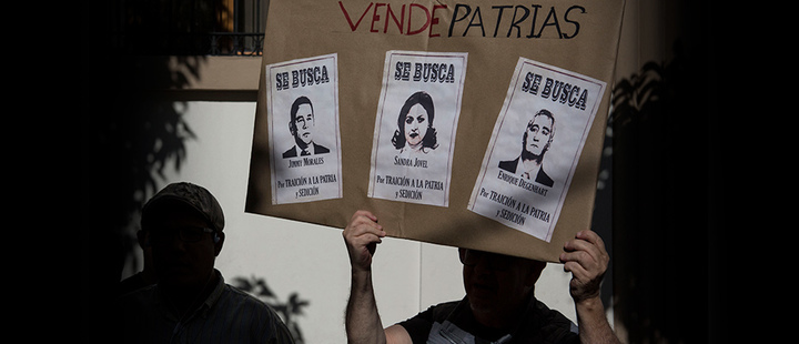 Demonstrators demand the resignation of Guatemalan President Jimmy Morales, featured in the poster that reads in Spanish