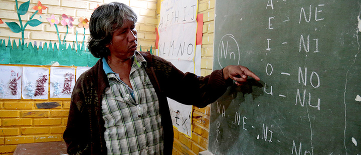 Teacher Blas Duarte shows letters in the Maka language at a school used by children of the Paraguayan ethnic group Maka, in Mariano Roque Alonso, Paraguay July 18, 2019.