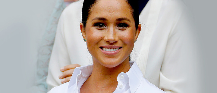 Meghan Markle, Duchess of Sussex smiles while sitting in the Royal Box on Centre Court on at the Wimbledon Tennis Championships in London.