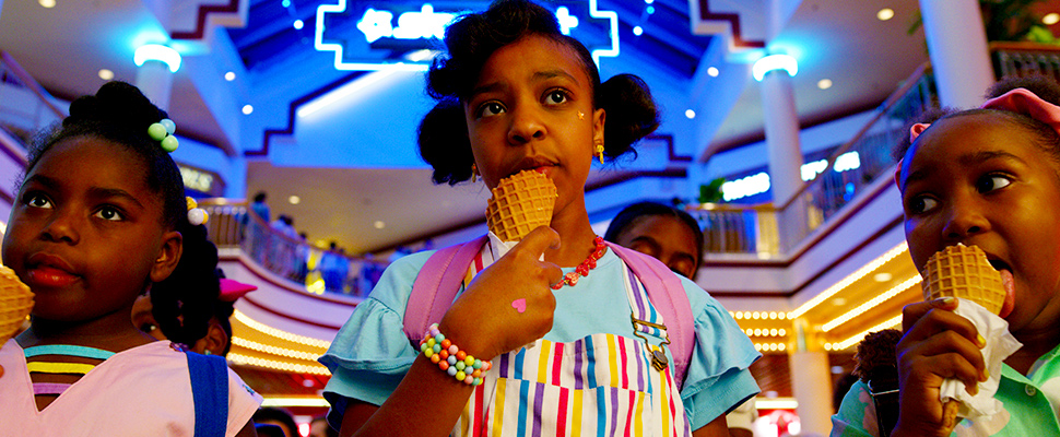 """This image released by Netflix shows Priah Ferguson, center, in a scene from """"Stranger Things."""""""