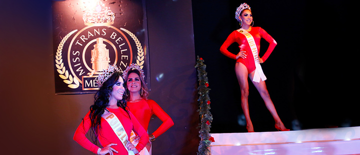 Contestants in the Miss Transgender Beauty pageant, from the Mexican states of Puebla, front left, and Colima stand during the opening event in Mexico City