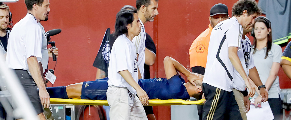 Marco Asensio being treated after his injury
