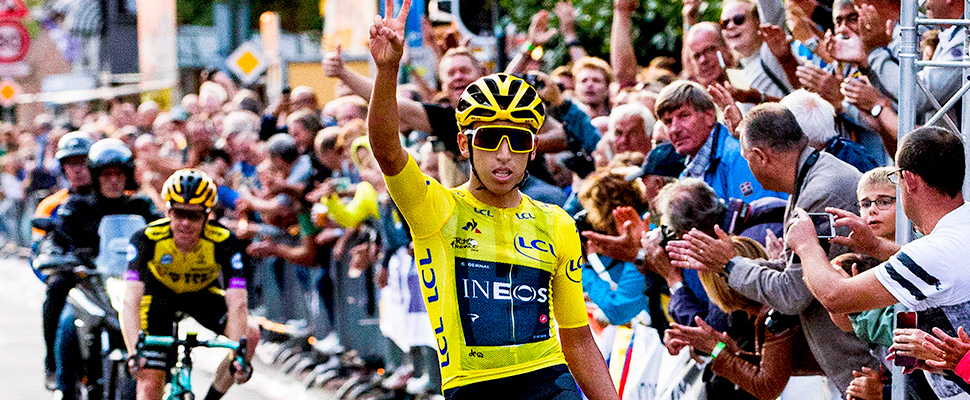 Colombia's Egan Bernal of Team Ineos, celebrates while crossing the finish line to win the Acht van Chaam cycling race in Chaam, Netherlands.