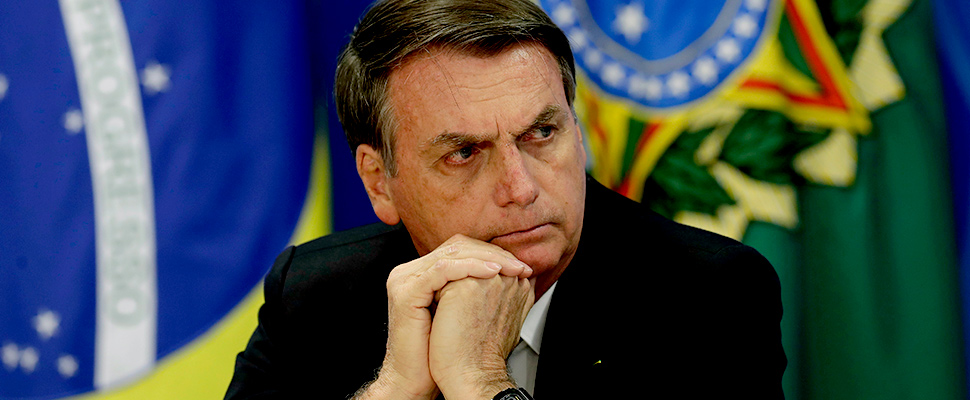 Brazil's President Jair Bolsonaro holds a press conference on deforestation in the Amazon at the Planalto presidential palace in Brasilia, Brazil